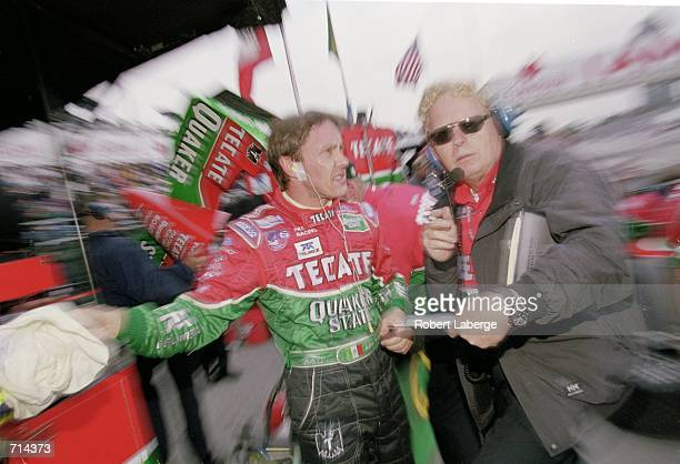 Adrian Fernandez meets with Engineer John Ward during the Molson Indy Vancouver, part of the 2000 CART FedEx Championship Series at the Concord...