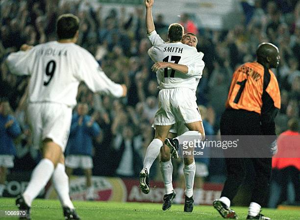 Alan Smith and Dominic Matteo of Leeds United celebrate during the UEFA Champions League match against Besiktas at Elland Road in Leeds England Leeds...