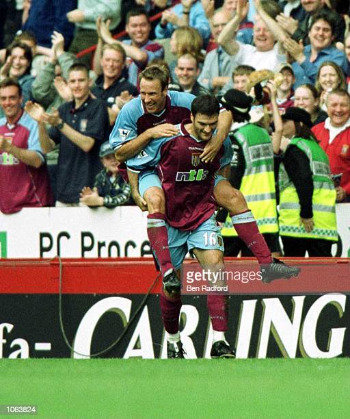 Alpay Ozalan of Villa celebrates with Paul Marson during the match between Aston Villa and Derby County in the FA Carling Premiership at Villa Park...
