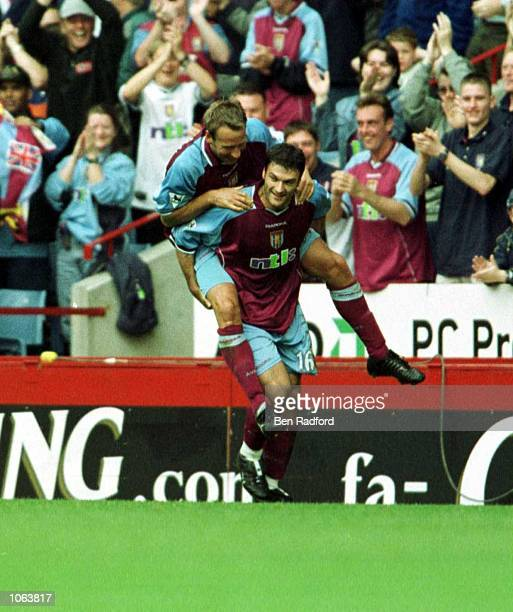 Alpay Ozalan of Villa celebrates with Paul Merson during the match between Aston Villa v Derby County in the FA Carling Premiership at Villa Park...