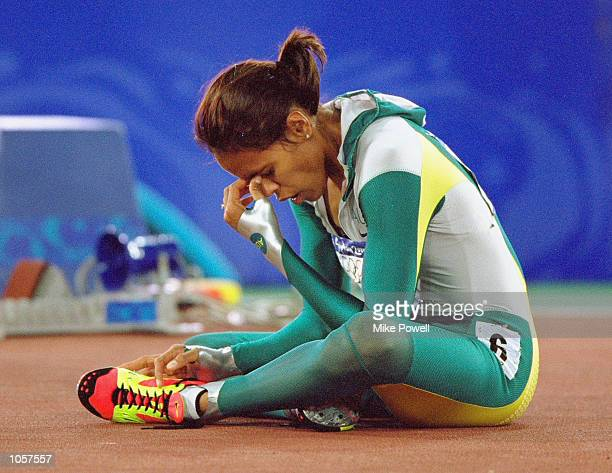 An emotional moment for Cathy Freeman of Australia after she wins gold in the Womens 400m Final at the Olympic Stadium on Day Ten of the Sydney 2000...