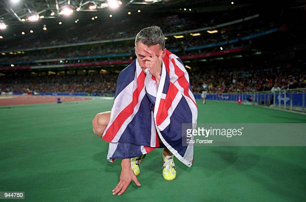 An emotional moment for Jonathan Edwards of Great Britain after winning gold in the Mens Triple Jump Final at the Olympic Stadium on Day 10 of the...