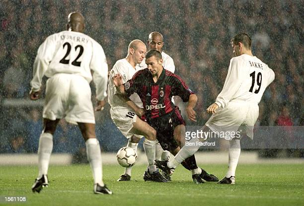 Andrei Shevchenko of AC Milan takes on the Leeds United defence during the UEFA Champions League match at Elland Road in Leeds England Leeds United...