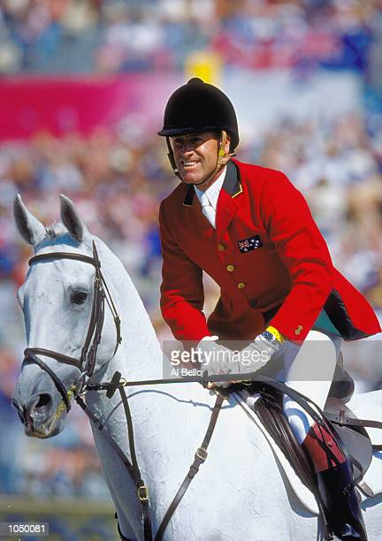 Andrew Hoy of Australia aboard Darien Powers celebrates their Gold Medal win in the Team Three Day Event at the Sydney International Equestrian...