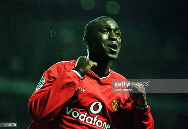Andy Cole of Man Utd celebrates his hattrick and the fifth goal during the Manchester United v RSC Anderlecht UEFA Champions League Group G match at...