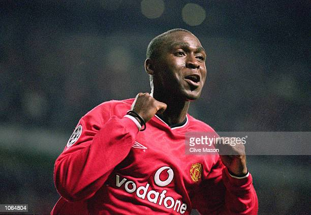Andy Cole of Manchester United celebrates during the UEFA Champions League match against Anderlecht at Old Trafford in Manchester England Manchester...