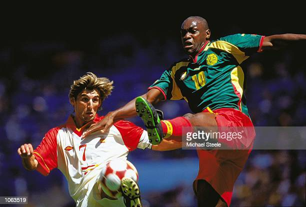 Angulo of Spain is challenged by Patrick Mboma of Cameroon during the Mens Football Final at the Olympic Stadium on Day 15 of the Sydney 2000 Olympic...
