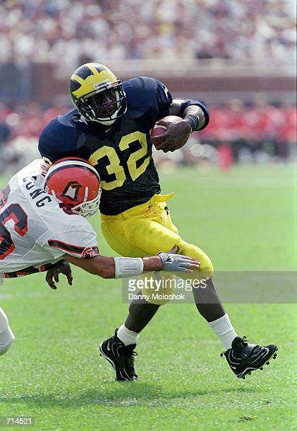 Anthony Thomas of the Michigan Wolverines avoids getting tackled during the game against the Bowling Green Falcons at Michigan Stadium in Ann Arbor...