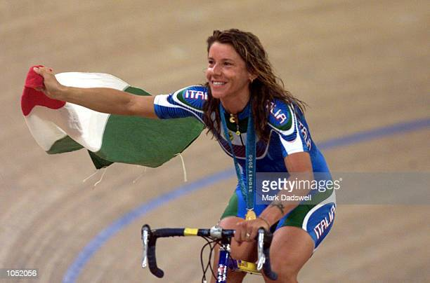 Antonella Bellutti of Italy celebrates winning the gold medal in the women's points race during the Sydney 2000 Olympic Games at the Dunc Gray...