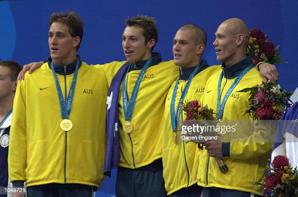 Ashley Callus Chris Fydler Michael Klim and Ian Thorpe of Australia celebrate with their Gold Medals after breaking the Men's 4x100 Freestyle Relay...