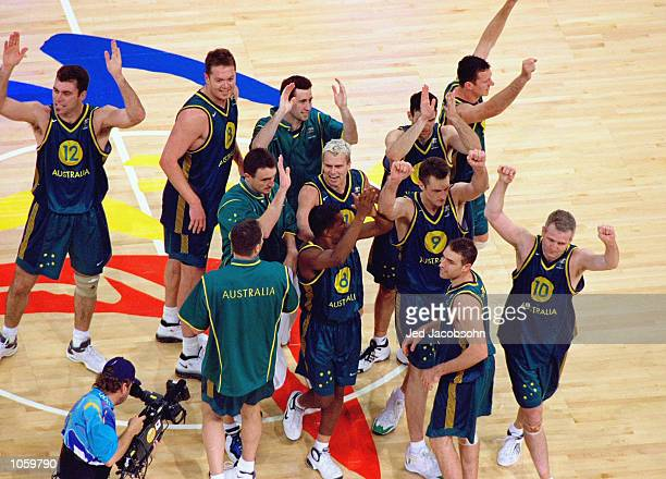 Australia celebrate after the Mens Baketball at the Sydney Superdome in the Olympic Park on Day Thirteen of the Sydney 2000 Olympic Games in Sydney...