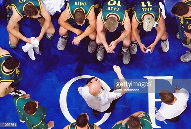 Australia coach Barry Barnes gives a team talk during the Mens Baketball at the Sydney Superdome in the Olympic Park on Day Thirteen of the Sydney...