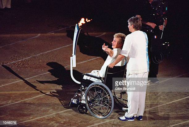 Australian legends Betty Cuthbert and Raelene Boyle carry the Olympic Torch during the Opening Ceremony of the Sydney 2000 Olympic Games at the...