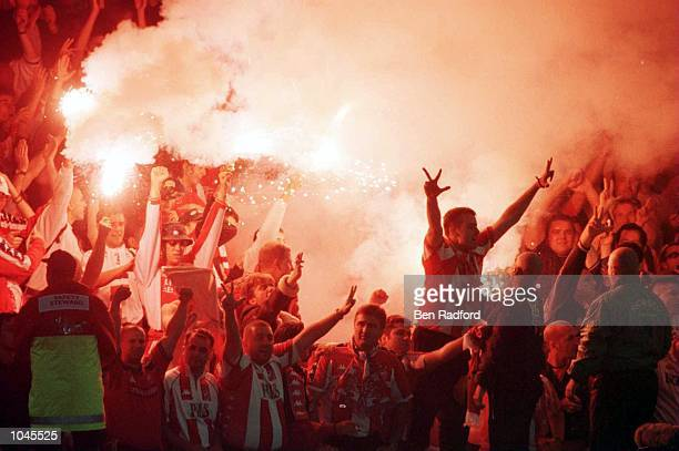Belgrade fans celebrate with flares during the match between Leicester City and Red Star Belgrade in the UEFA Cup First Round First Leg at Filbert...