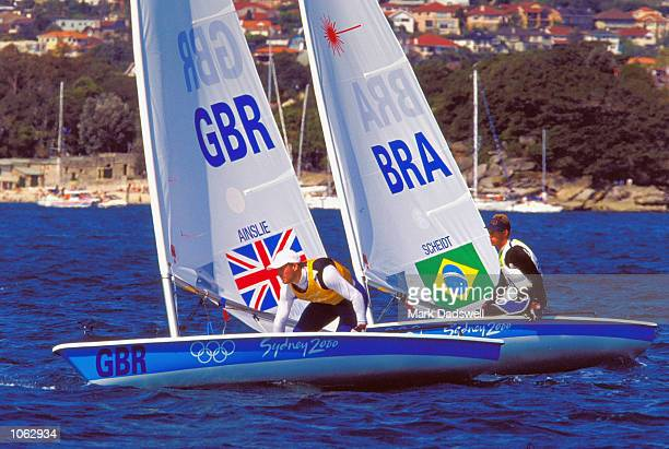 Ben Ainslie of Great Britain on his way to Gold and Robert Scheidt of Brazil sailing to Silver in the Mens Open Laser Fleet Races at Rushcutters Bay...