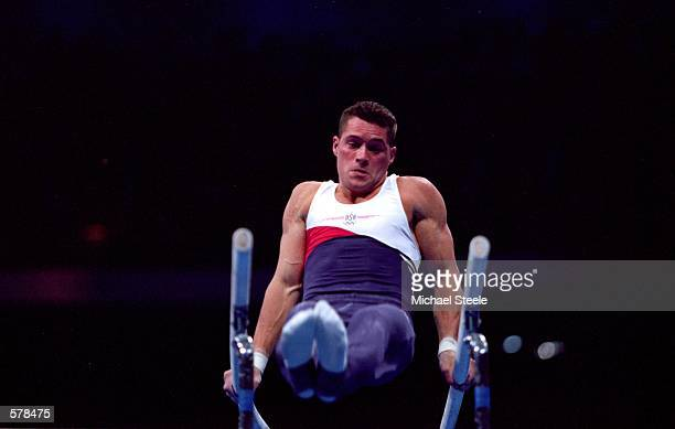 Blaine Wilson of the USA pulls himself up on the Parrallel Bars Qualifing Event for the 2000 Sydney Olympics at the Sydney Superdome in Sydney...