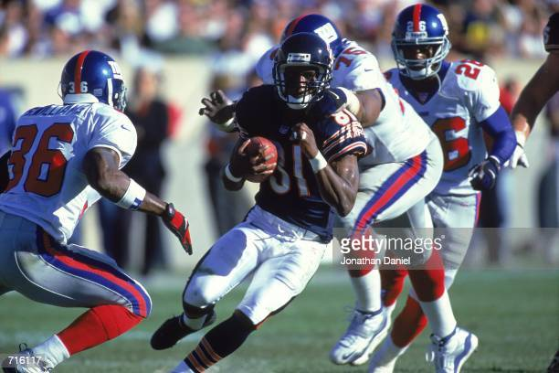 Bobby Engram of the Chicago Bears gets chased by Shaun Williams and Keith Hamilton of the New York Giants during the game at Soldier Field in Chicago...