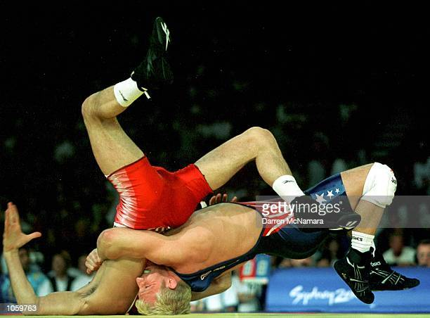 Bousvaissa Saitiev of Russia and Brandon Slay of the USA in action in the 76kg Freestyle Wrestling match at the Sydney 2000 Olympic Games held at...
