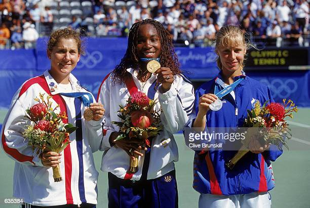 Bronze Medal winner Monica Seles of the USA poses with Venus Williams of the USA who wins the Gold Medal and Silver Medal winner Elena Dementieva of...