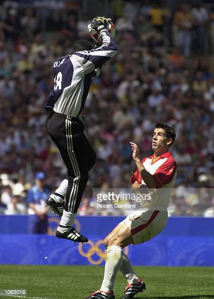 Cameroon Goalkeeper Carlos Idriss Kameni flies high during the Men's Gold Medal Soccer Match between Cameroon v Spain at the Sydney 2000 Olympic...