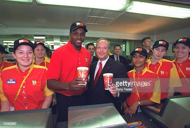 Carl Lewis of the USA at McDonalds Central in Sydney before the start of Day One of the Sydney 2000 Olympic Games in Sydney Australia Mandatory...