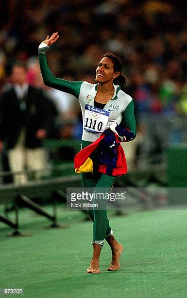 Cathy Freeman of Australia celebrates after winning gold in the Women's 400m final held at Olympic Stadium during the Sydney 2000 Olympic Games...