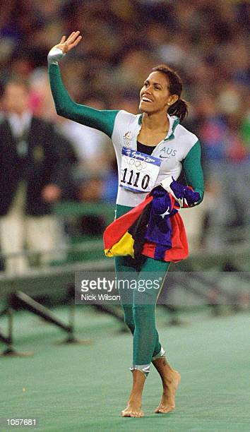 Cathy Freeman of Australia celebrates gold in the Womens 400m Final at the Olympic Stadium on Day Ten of the Sydney 2000 Olympic Games in Sydney...