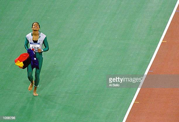 Cathy Freeman of Australia celebrates winning gold in the Womens 400m Final at Olympic Stadium on Day Ten of the Sydney 2000 Olympic Games in Sydney...