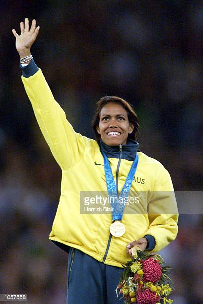 Cathy Freeman of Australia celebrates with her Gold medal after winning the Women's 400m final at the Sydney 2000 Olympic Games, Sydney Australia....
