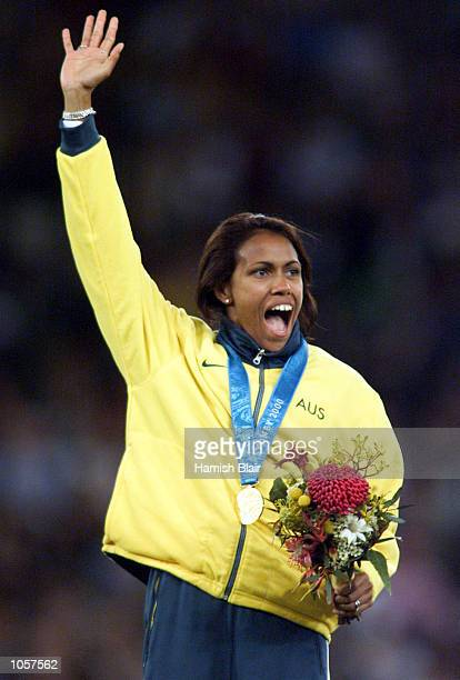 Cathy Freeman of Australia celebrates with her Gold medal after winning the Women's 400m final at the Sydney 2000 Olympic Games Sydney Australia...