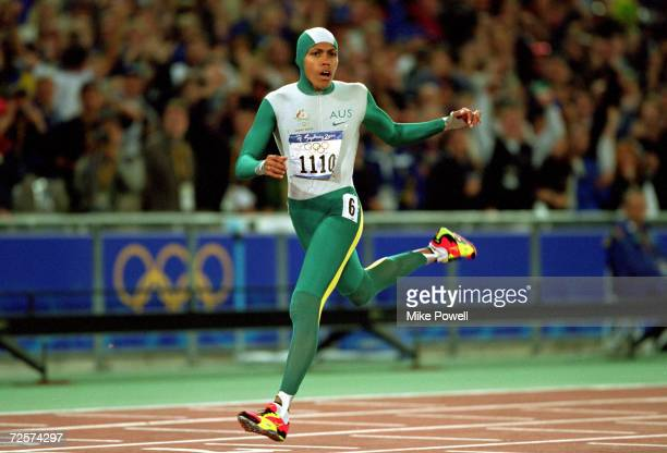 Cathy Freeman of Australia crosses the line to win gold in the Womens 400m Final at the Olympic Stadium on Day 10 of the Sydney 2000 Olympic Games in...