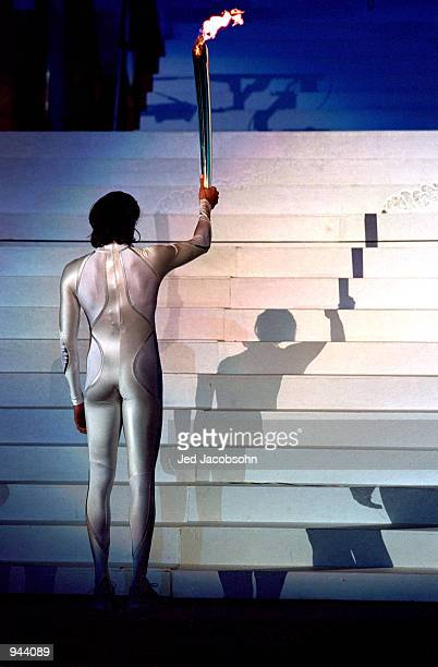 Cathy Freeman of Australia holds the torch as she prepares to light the Olympic Flame during the Opening Ceremony of the Sydney 2000 Olympic Games at...