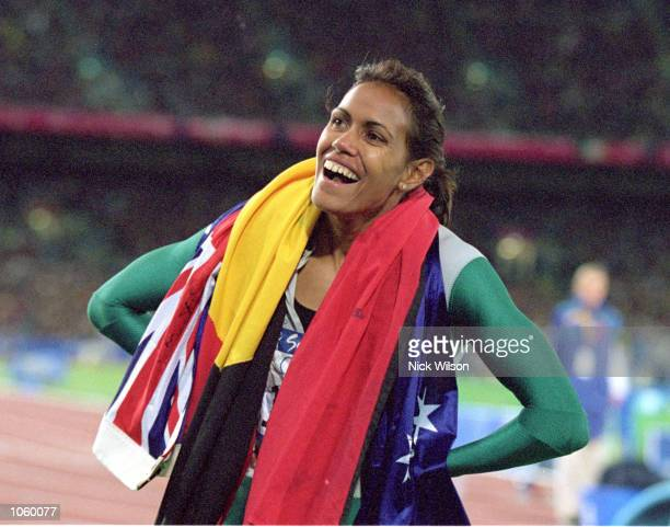Cathy Freeman of Australia is elated after winning Gold in the 400m Final during the 2000 Sydney Olympic Games at Stadium Australia in Sydney...