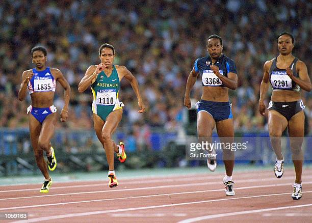Cathy Freeman of Australia Nanceen Perry of the USA and Beverly McDonald of Jamaica in the Womens 200m Heats in the Olympic Stadium on Day 12 of the...