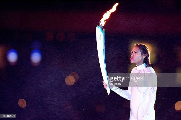 Cathy Freeman of Australia prepares to light the Olympic Flame during the Opening Ceremony of the Sydney 2000 Olympic Games at the Olympic Stadium in...