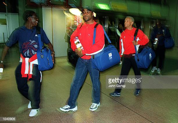 Christian Malcolm Darren Campbell Jamie Baulch and Dwain Chambers of Team GB head for passport control with their Marks Spencer luggage before...