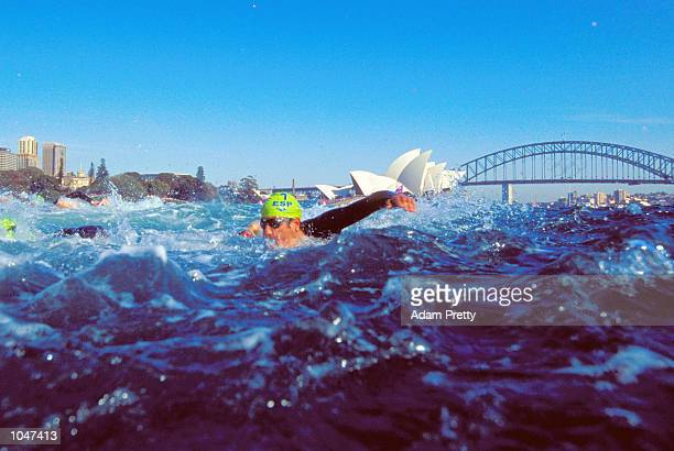 Competitors in action during the swim leg of the Men's Triathlon at the Opera House during Day Two of the Sydney 2000 Olympic Games in Sydney...