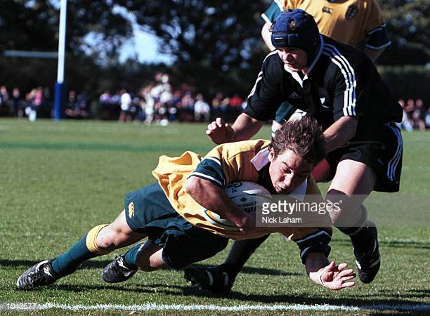 Dallas Carney of Australia scores the first try for Australia during the Australia v New Zealand Schoolboy Rugby match at St Joseph's College in...