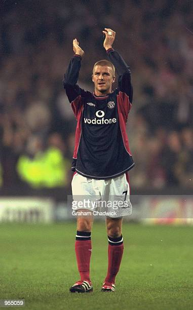 David Beckham of Manchester United applauds the fans after the UEFA Champions League match against PSV Eindhoven played at the Philips Stadium in...