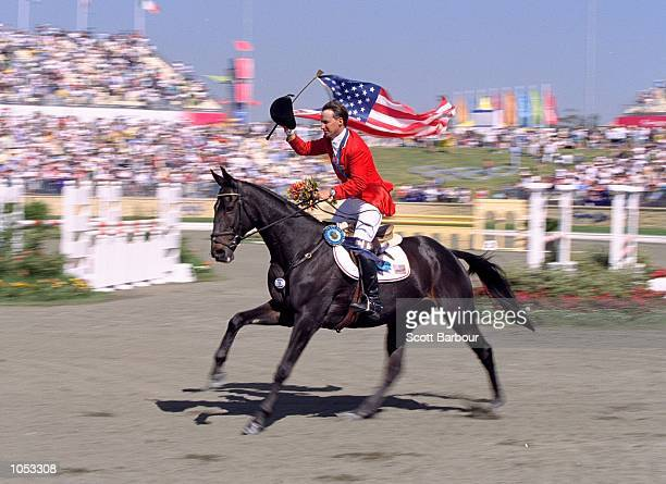 David O''Connor of the USA aboard Custom Made celebrates his Gold Medal win in the Individual Three Day Event Show Jumping at the Sydney...