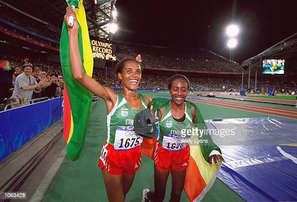 Derartu Tulu of Ethiopia celebrates winning Gold in an Olympic Record time during the Womens 10000m Final at the Olympic Stadium on Day 15 of the...