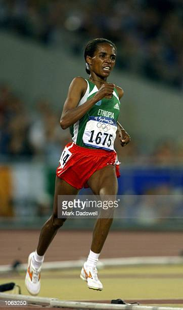 Deratu Tulu of Ethiopia in action on her way to winning gold in the Womens 10000m Final during the 2000 Sydney Olympic Games at the Olympic Stadium...
