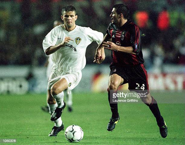 Eirik Bakke of Leeds United gets past Andres Guglieminpietro of AC Milan during the match between Leeds United and AC Milan in the Champions League...