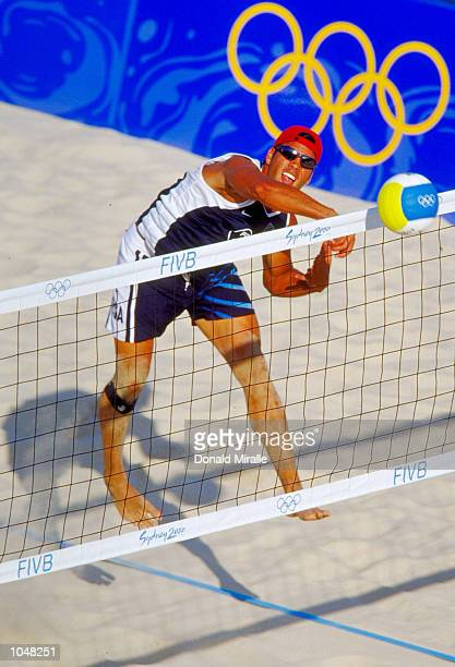 Eric Fonoimoan of the USA spikes during the Men's Beach Volleyball Eliminations against Germany at Bondi Beach on Day Two of the Sydney 2000 Olympic...