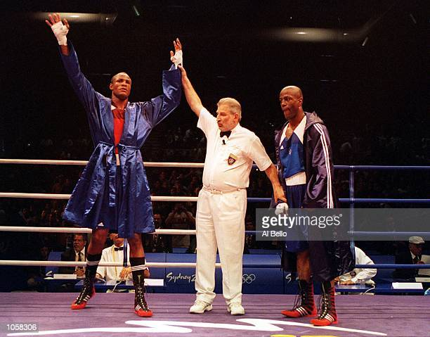 Felix Savon of Cuba celebrates his victory over Michael Bennett of the USA in the 91 kilogram boxing bout held at the Sydney Convention and...