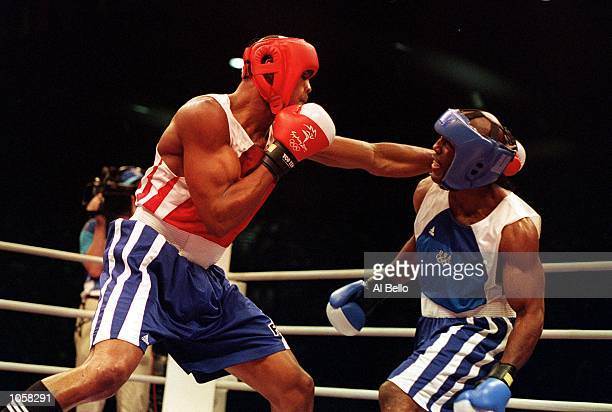 Felix Savon of Cuba in action during his victory over Michael Bennett of the USA in the 91 kilogram boxing bout held at the Sydney Convention and...