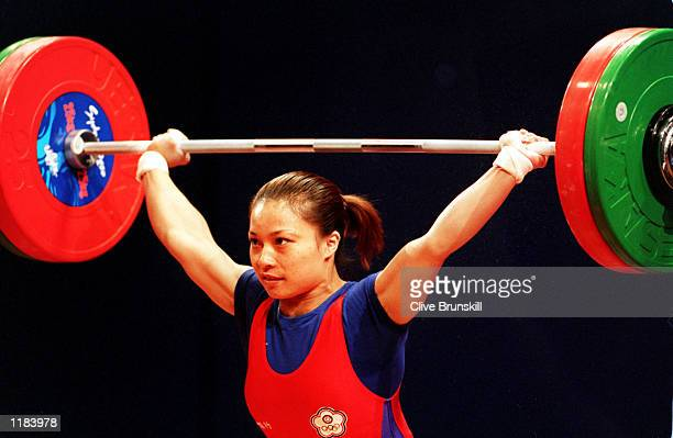 Feng Ying Li of Taipei who won the silver medal lifts in the Womens 53 kilogram weightlifting category held at the Sydney Convention and Exhibition...