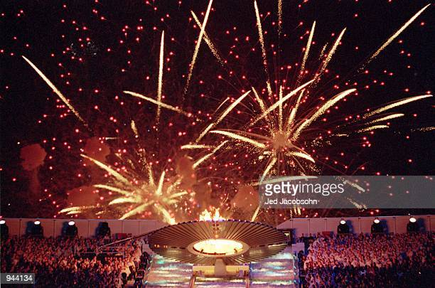 Fireworks greet the ascending Cauldron containing the Olympic Flame during the Opening Ceremony of the Sydney 2000 Olympic Games at the Olympic...