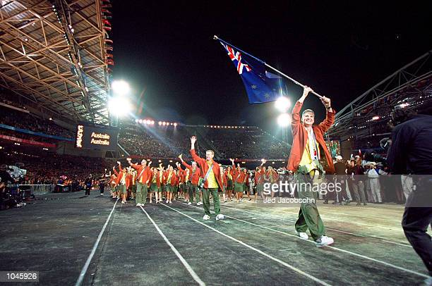 Flag Bearer and Basketball competitor Andrew Gaze leads round the Australian Olympic Team during the Opening Ceremony of the Sydney 2000 Olympic...