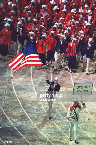 Flag Bearer and canoe competitor Cliff Meidl leads round the USA Olympic Team during the Opening Ceremony of the Sydney 2000 Olympic Games at the...
